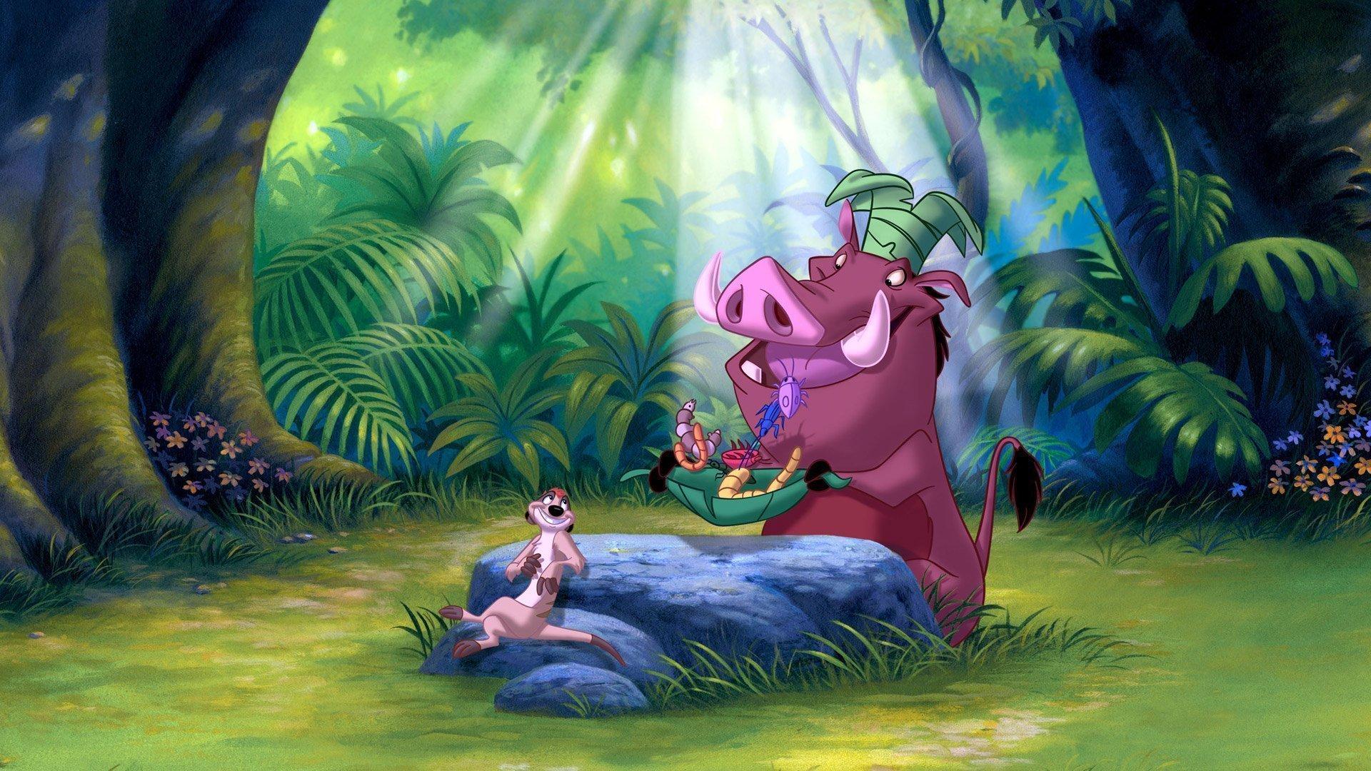 Timon und Pumbaa genießen an einem Stein ein Festmahl